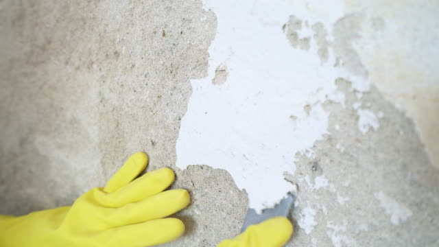 Repairing a damaged concrete wall. video