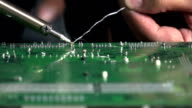 Repairing solder weld, fuse together by heating a lead to melt at the back of motherboard video