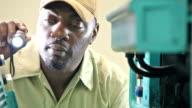 Repairman examining equipment with flashlight video