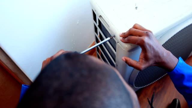 Repairman fixing air conditioning video