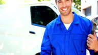 Repairman with tools and thumbs up video