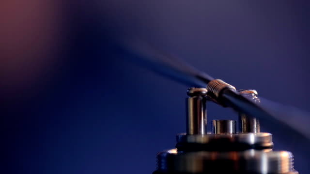 Replacement spiral microcoil at base of clearomizer with coil jig closeup video