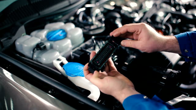 Replacing a car engine parts. video