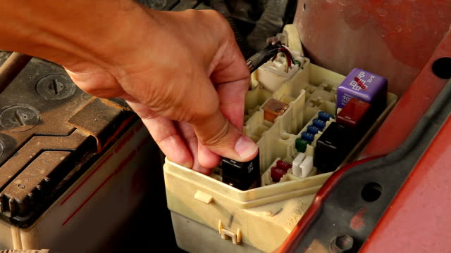 Replacing or inspecting a car fuse. video