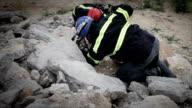 Rescue team over the rubbles video