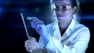 Researcher working in laboratory. video