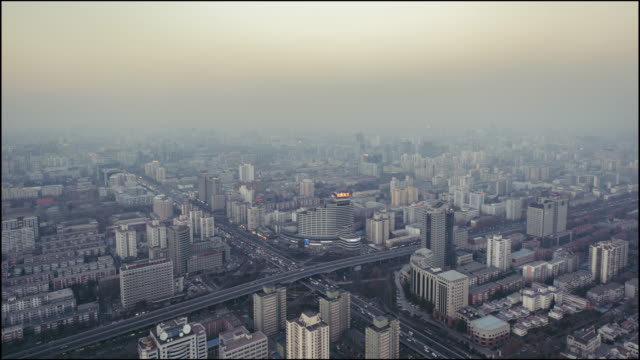 T/L Residential Area and Road Intersection in Air Pollution, Day to Night Transition / Beijing, China video