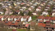 AERIAL: Residential row houses in beautiful suburban town video