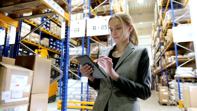 Responsible manager with tablet in warehouse video
