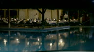 Restaurant by swimming pool on resort in the evening video