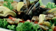 Restaurant food. Grilled fish and vegetables video
