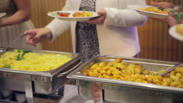Restaurant guests select food from a buffet video
