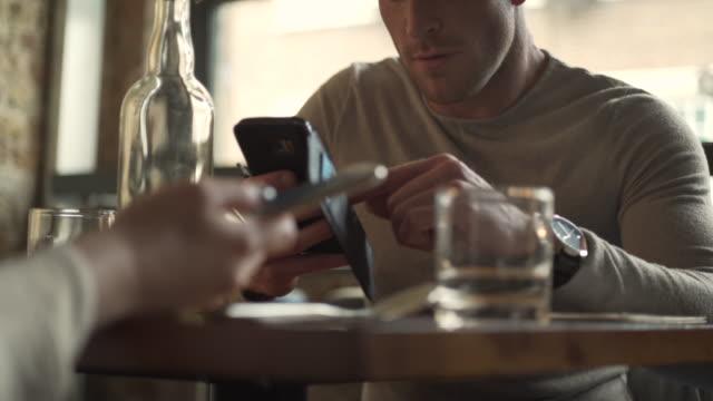restaurant phone couple video