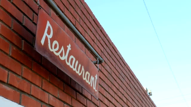 Restaurant Sign Shakes in the Wind on a Clear Day video