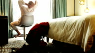 Resting man rotates in swivel chair  in luxury hotel room video