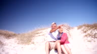 Retired couple enjoying time together at the beach video