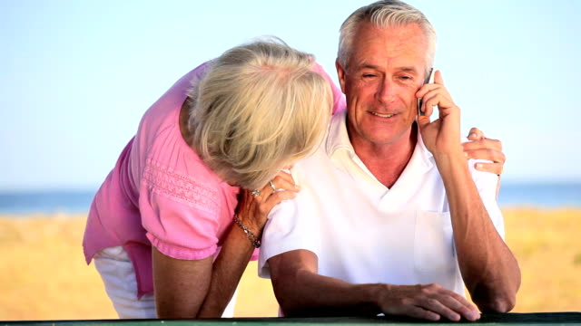 Retired Couple Using Cell Phone video