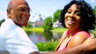 Retired Ethnic Couple Relaxing Park Bench video