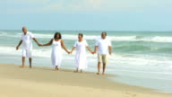 Retired Ethnic Couples Strolling Beside Ocean video