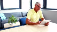 Retired man using tablet computer video