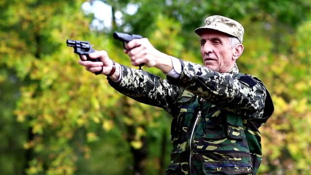 Retired officer at shooting range video