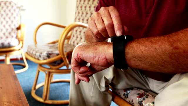 Retired person is using smart watch video