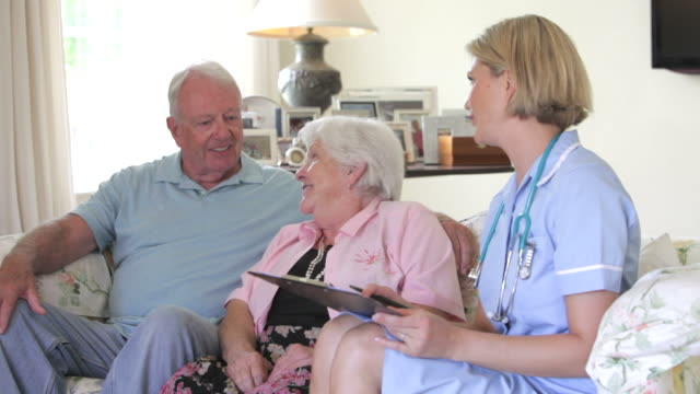 Retired Senior Couple Having Health Check With Nurse At Home video