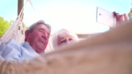 Retired senior couple taking a selfie with their smart phone video