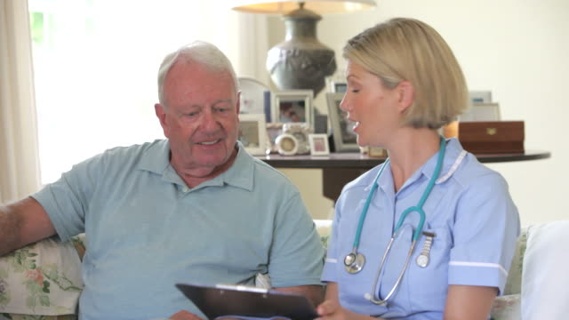Retired Senior Man Having Health Check With Nurse At Home video