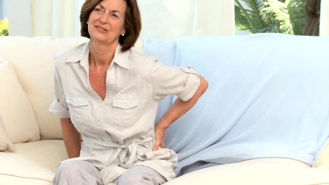 Retired woman with a back pain video
