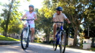 Retirement Cycling Exercise by Healthy Senior Couple video