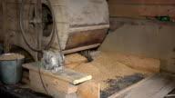 Retro automatic handmade machine sifting grain in barn. Closeup video
