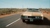 Retro car driving on road video