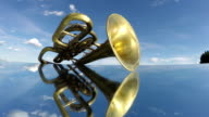 retro musical brass wind instrument on mirror and clouds motion. Timelapse video