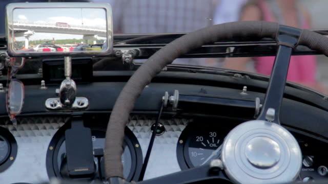 Retro vehicle front panel, rear view mirror, vintage speedometer video