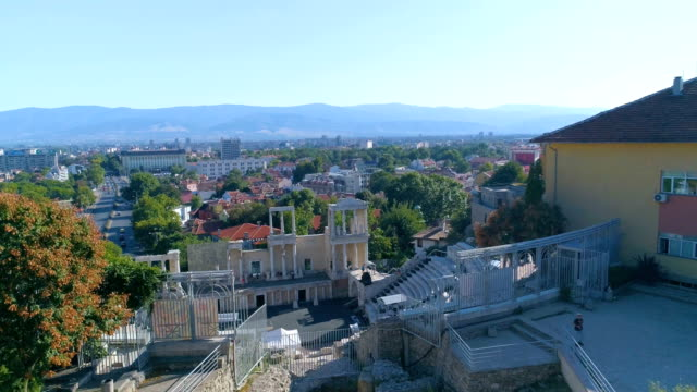 Revealing drone shot of an ancient roman amphitheater in the old town of Plovdiv video