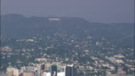 Revealing Hollywood From the Hill Top Sign  - Aerial View - California,  Los Angeles County,  United States video