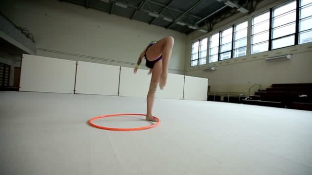 Rhythmic gymnastics: Girl training a gymnastics exercise with a hoop video