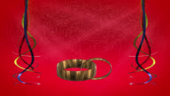 Ribbons and gold rings with red background loop ready video