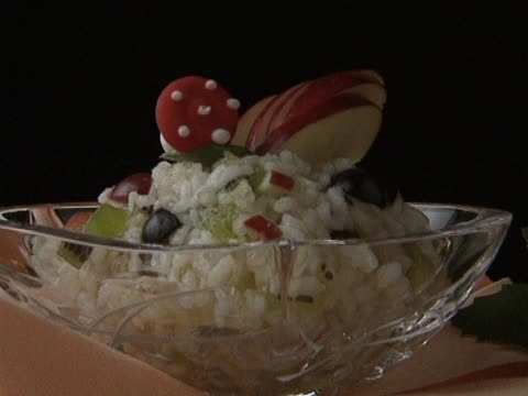 Rice with fruit in glass bowl video