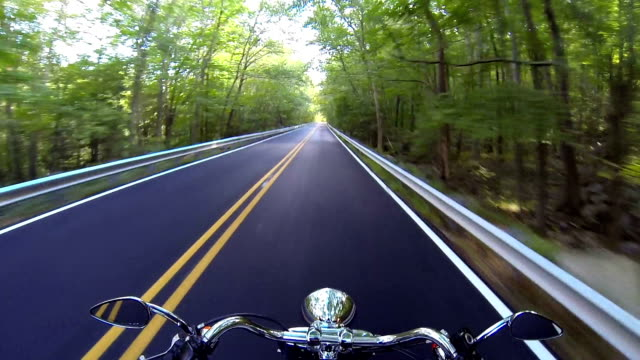Ride a fast moving motorcycle through the country side video