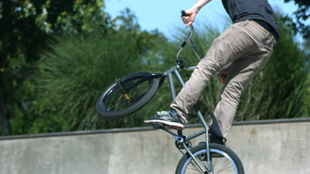 BMX rider doing a 360 air, slow motion video