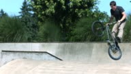 BMX rider doing a tail whip, slow motion video