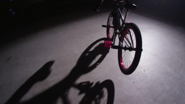 BMX rider in dark warehouse video