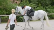PAN Rider practicing on the horse with a trainer video