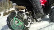 ATV riders on winter snow racing. Super slow motion of snow fly toward camera video