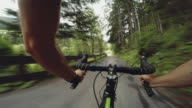POV riding a road racing bicycle in the forest video