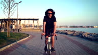 HD: Riding Bicycle at Sunset video