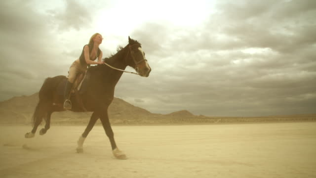 (Slow Motion) Riding Horses in the Dessert 04 video