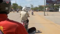 SIEM REAP, CAMBODIA - NOV 2015: Riding motor bike on street video